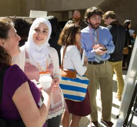 candidates speaking at poster session